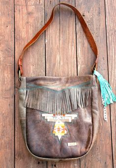 HOLD//Rad cowboy brown leather purse with hand-cut Pendleton wool thunderbird, fringe, red floral lining, hand-stitched mint arrow, & tassel