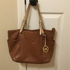 ⚡️NEWLY LISTED⚡️Michael Kors Tan Leather Jet Set Beautiful tan leather Michael Kors purse! Top has a zipper closure and two pockets on the side. There are a few spots as shown. Thanks for shopping my closet! No trades Michael Kors Bags Shoulder Bags
