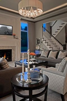 transitional living room by Tutto Interiors .