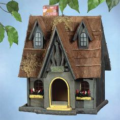 Thatch Roof Cottage Birdhouse with Chimney.