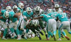 New York Jets' Zac Stacy, centre, scores a touchdown in the third quarter during the NFL football game between the New York Jets and the Miami Dolphins and at Wembley stadium in London, Sunday, Oct. 4, 2015. (AP Photo/Tim Ireland)