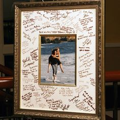 "The couple didn't want a traditional guestbook, so they had their guests sign a framed photo from their engagement-portrait session. ""We have it hanging in our home now,"" says Kelly."