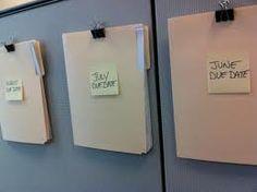 Cubicle Wall Folder   You will need:  Push Pins, Medium Sized Binder Clips and Manila Folders