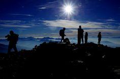 Climbers at the summit relishing the joy of achievement (Karamatsu-dake is a peak of the Japanese Alps)