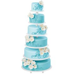 Sky Blue Spectacle Cake - Design your cake as a garden growing to new heights! Our Towering Tiers Cake and Dessert Stand will allow your baked goods to be on a wonderful display. Beautiful flowers trail up the calming light blue tiers. It's a celebration cake beyond compare in style and majesty.