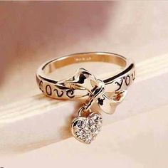 Bow ring with heart dangle