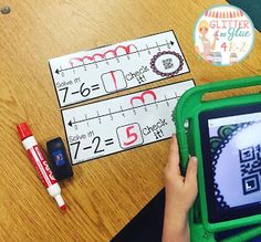 Centers that promote independence. Using QR Codes and iPads in the classroom. Kindergarten number line practice. Teach addition and subtraction strategies.