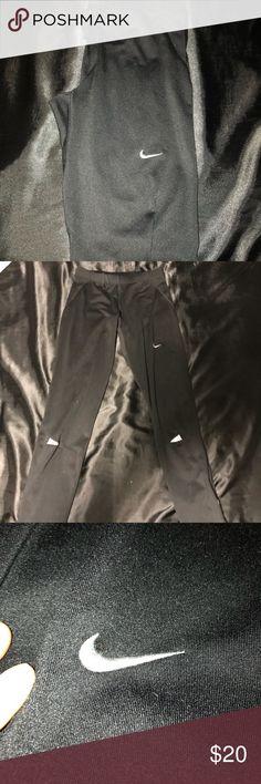 Nike Dri-Fit Leggings Amazing condition! Zipper over the ankle. Super comfortable Nike Pants Leggings