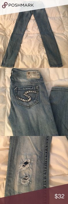 Silver skinny jeans! Size 25! Light wash silver skinny jeans they are the November style. Destroyed style with patches under the holes! GREAT quality jeans! Rhinestones along the back pockets and some on the front pockets and front button. These are a size 25 and have a slight stretch to them! Really don't want to part with these but they have become too small 😞 Silver Jeans Jeans Skinny