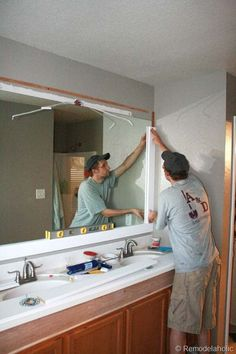 Bathroom Mirror Makeover how to frame out that builder basic bathroom mirror (for $20 or