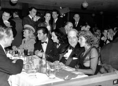 William Randolph Hearst is seen at a Military Ball in Hollywood, Ca. on April 15, 1942. Seated at the table in his row from left to right are: Marion Davies, in uniform, first medical battalion of California State Guard; actor George Montgomery; Hedy Lamarr; Hearst; Rita Hayworth.