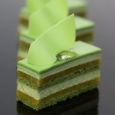 Gateau - a rich cake, typically one containing layers of cream or fruit. The Asian flavour of matcha can be overpowering for some but it works perfectly with mango and passionfruit in this petit gateau # fancy Desserts Matcha Gateau Cake Fancy Desserts, Asian Desserts, Sweet Desserts, Delicious Desserts, Dessert Recipes, Zumbo Desserts, Gateau Cake, Matcha Cake, Matcha Milk