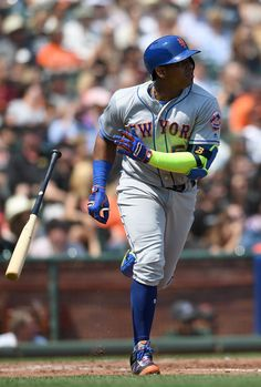 Yoenis Cespedes Photos - Yoenis Cespedes #52 of the New York Mets tosses his bat…