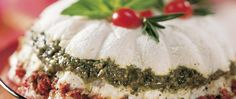 Make-ahead recipe! A buffet table becomes beautiful with lovely layers of cream cheese, pesto and sun-dried tomatoes.