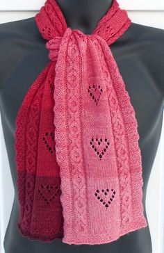 Free Until Jan 31 2018 Knitting Pattern for Hole Hearted Scarf -  Scarf with lace hearts and xoxo hugs and kisses cables. Fingering weight yarn. Designed by Brenda Vanlerberghe.