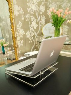 I am in love with this. Wow. $98.00 lucite laptop stand from the French Apartment