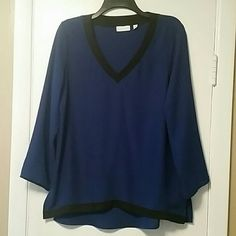 Shirt 100% Polyester top. Royal blue with black hem and collar. 3/4 sleeve. Shorter in front as compared to back. Really cute top. Never wore it out. Just wasn't for me. New York & Company Tops Blouses