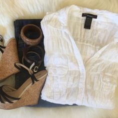 NWOT Simple Chic White Blouse NWOT. Sunny Day ready White Blouse, pair it with your favorite Jean or over your swim suit, it's perfect 95% Cotton 5% Spandex. 2 front pockets 4 button down front  ✅will Bundle  ✅ ✅ all reasonable offers will be considered No Trading  Poshmark rules only‼️ Measurements taken laying flat Ⓜ️ chest 22  Ⓜ️length 28 Fashion Model  Tops Blouses