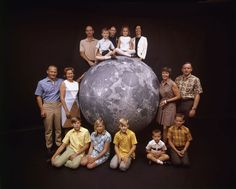 The Apollo 11 astronauts and their families pose with a scale model of the moon, spring 1969 Photo by Ralph Morse for Life magazine
