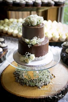 Rustic chic wedding cake with chocolate frosting, lace, white roses and babies breath!