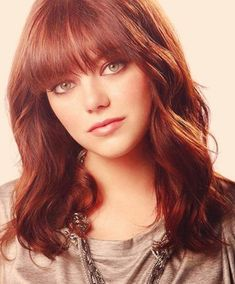 Emma Stone Hairstyles: Medium Wavy Haircut with Blunt Bangs and Rockin' Red Color. Total envy!