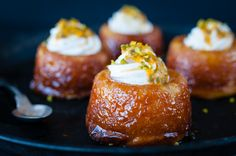 A rum baba or baba au rhum is a small yeast cake saturated in syrup made with hard liquor usually rum and sometimes filled with whipped cream or pastry crea Desserts Français, Alcoholic Desserts, Plated Desserts, Delicious Desserts, Dessert Recipes, Baba Rum Cake, Food Network, Parfait Recipes, Savarin
