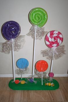 lollipops - large ones made from swimming pool noodles; create stripes with ribbon