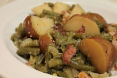 Try this delicious southern mash with some green beans, bacon and potatoes. The variety of flavors adds so much when paired together. Southern Green Beans, Southern Fried Cabbage, Southern Greens, Southern Dishes, Southern Recipes, Slow Cooked Green Beans, Green Beans With Bacon, Vegetable Side Dishes, Vegetable Recipes