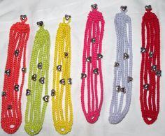 Bracciali cotone uncinetto vari colori con cuori in metallo : Braccialetti di giovanna-cargnelli