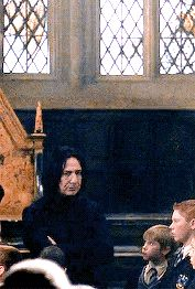 "Alan Rickman as Professor Severus Snape - this GIF is from ""Harry Potter and the Chamber of Secrets;"" it's at the start of Gilderoy Lockhart's ill-advised dueling club."