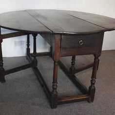 This is a beautiful 17th Century oak, gate leg table. In good condition. The table does have all the normal age related marks. Please note this table is at least 300 years old!!  Having said this the table is in good condition for its age. There is wood worm to the legs and bottom of drawer however this is only to be expected of a table this age. All of the woodworm has been treated and is not active. Measurements of this table are approx.: 72cm tall, 137cm long, 138cm wide (with leaves up)…