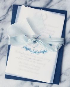 I'm over the moon about this new client's invite suite. Shades of blue, ivory…