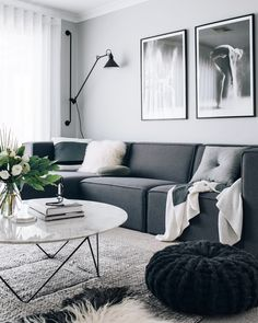 Monochrome living room with Scandinavian-inspired wall art.