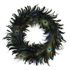 Peacock feather wreath at Kirklands... MUST HAVE IN MY HOME!