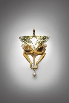 Lalique signed Gold & enamel brooch representing two winged figures in Symbolist decoration, holding their heads in their hands ivory. The body placed on a raised floral motif, enamel wings applies to day. It is embellished with a pearl tassel. Bears the signature LALIQUE back right. Lacks pin, probably later transformed into a pendant