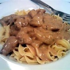 Cubed sirloin tips baked with mushrooms in cream of mushroom soup mixed with beef and onion soup mix. Served over egg noodles. Great with dinner rolls or garlic toast.