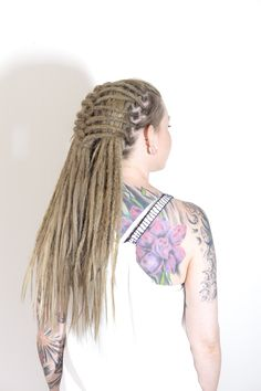 This is Tess, about three months ago she started out with trying out synthetic dreadlocks, she loved it so much that she booked an appointment for real dreadlocks yay. Here is Tess with dreadlocks on her own hair and human hairextensions for length. She loves her new look!