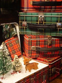 Mom has a huge collection of plaid tins and thermoses! She could use them like this at holidays!