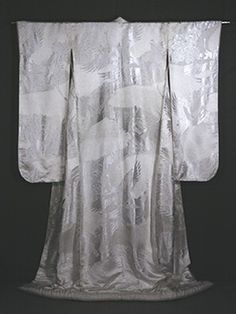 """A shiromuku is the traditional white or off-white Japanese kimono worn for the wedding ceremony itself. These have normally been brocaded, damask or embroidered garments. Cranes and floral motifs predominate. Because of the contrasting reflective surfaces. these garments have sometimes been called """"triple whites."""" Some of the loveliest are soft eggshell-colored silk satins."""