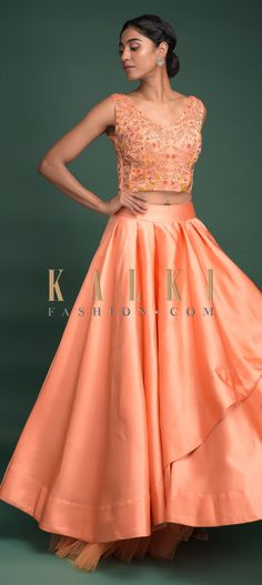 Buy Online from the link below. We ship worldwide (Free Shipping over US$100)  Click Anywhere to Tag Peach Lehenga In Milano Satin With Pleated Overlapping Layer And Embroidered Corset Online - Kalki Fashion Peach lehenga in Milano satin with pleated overlapping layer and net under layer.Matched with a yellow and peach shaded net dupatta with cut dana highlighted border.