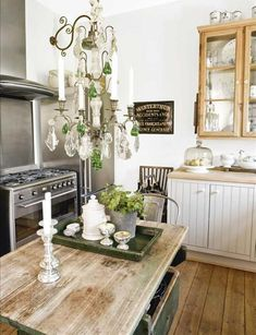 Shabby Chic Decorating Ideas--Love this chandy in the kitchen (and it even has green crystals!)