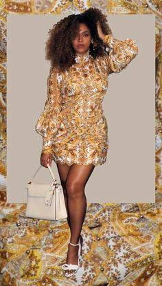 Serving us bawdy and face, The Lion King star stuns in a bronze, yellow lace mini-dress by Zimmermann. If anything, she's exudes glamour with the addition of her mod-style sandals by Zimmermann and Valentino purse. Beyonce 2013, Beyonce And Jay Z, Beyonce Pictures, Beyonce Coachella, Divas, Lisa Bonet, Beyonce Style, Hollywood Icons, Classic Hollywood