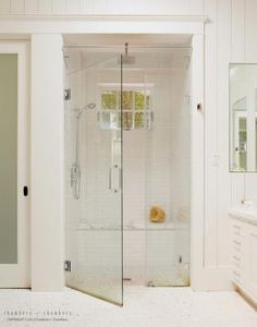 Shower with bench and window.
