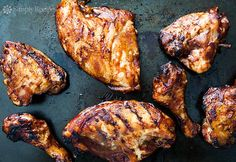 Slow barbecued chicken on the grill, slathered with your favorite barbecue sauce.