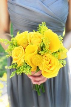 A beautiful combination of yellow wedding flowers including roses, mini-calla lilies, craspedia (billy balls) and solidago. All of these flowers are available year-round at GrowersBox.com.