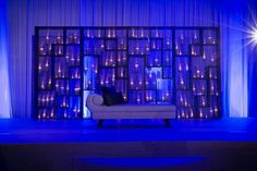 Candles Frames: It lite ups the room in such a way no other thing can do. It has a perfect way of putting in its own charm in event #symmetrical #elegant #candlestands #bridengroomsitting #i2cevents #bluethemewithcandles