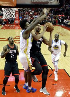 factory authentic 9ded4 0b225 Houston Rockets  Eric Gordon goes up for a a shot as Golden State Warriors   Nick Young defends during the first half of an NBA basketball game  Thursday, ...