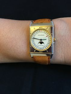 A stainless steel and gilt rectangular wristwatch with date and moon phases