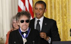 President Barack Obama presents Bob Dylan with a Medal of Freedom, 2012