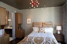 Create coziness with a painted ceiling. For some reason, most of us don't give much thought to color on the ceiling, opting for basic white or matching the wall color. But a rich, contrasting hue on the ceiling can add a sense of depth and warmth in a wonderfully subtle way, perfect for bedrooms and living rooms.